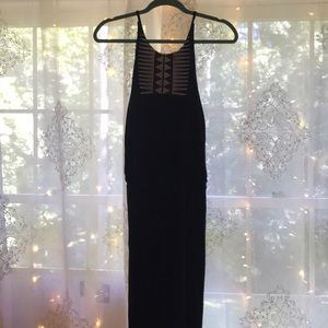 Black maxi dress with embroidered detail on neck